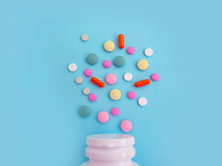 vitamin pill on a colored background