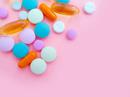 pills vitamins on a colored background Stock fotó - 154855429