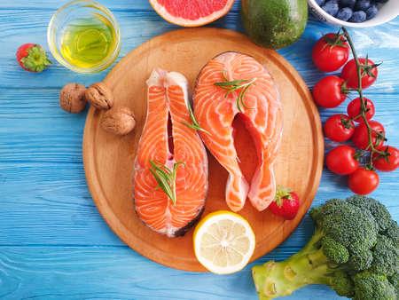 fresh salmon tomato, on wooden background