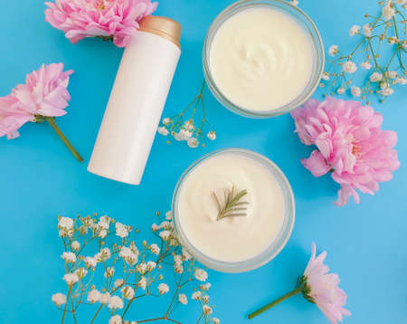 cosmetic cream, flower on a colored background