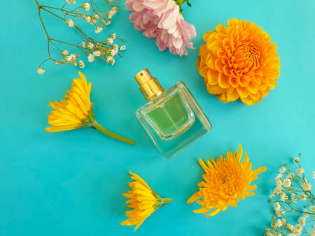 bottle perfume flower on a colored background
