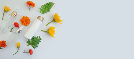 cosmetic cream, flower on a light background