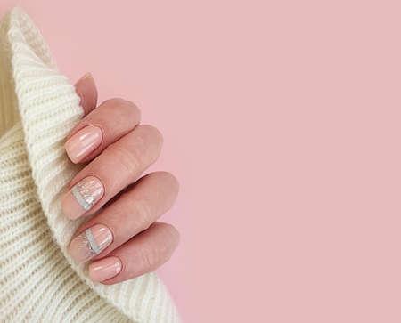 female hand beautiful elegant manicure sweater