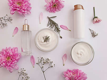 cosmetic cream, flower on a background