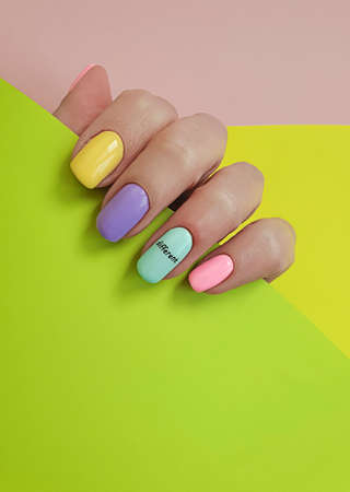 female hand beautiful manicure on a colored background