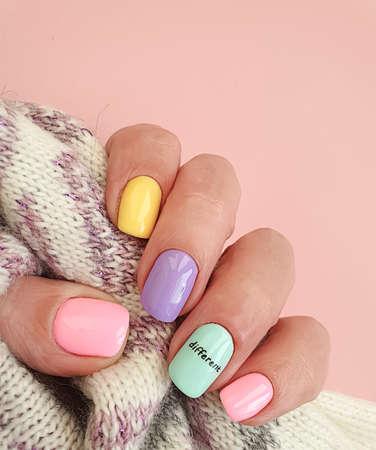 female hand beautiful colored manicure