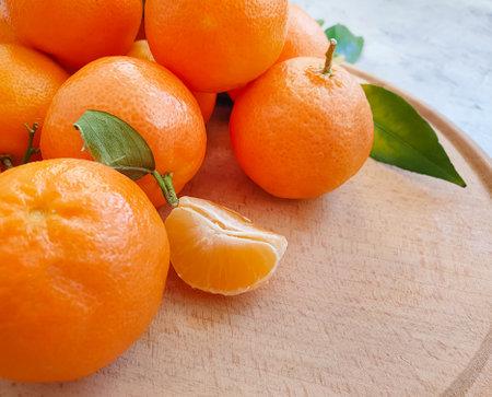 fresh tangerines on concrete background