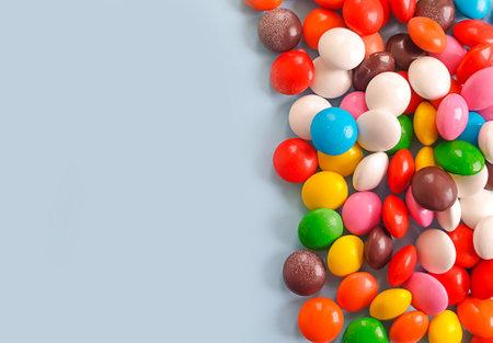 multicolored sweet candies on colored background Zdjęcie Seryjne