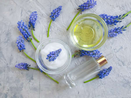 cosmetic cream, flower on concrete background