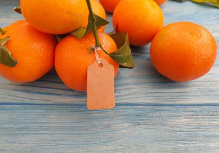 fresh tangerines on wooden background Zdjęcie Seryjne