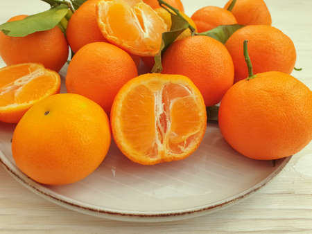 fresh tangerines on wooden background nature