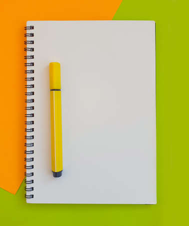 notebook, felt-tip pen on a background of colored paper