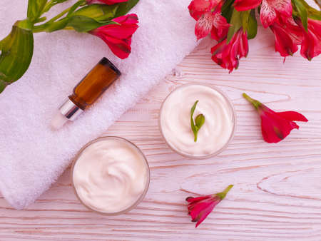 cream cosmetic flower on background