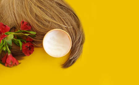 cosmetic hair mask on a colored background
