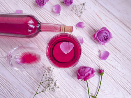 wine glass flower rose on wooden background