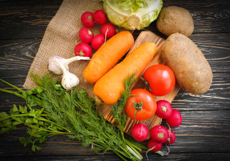 organic vegetables on an old wooden background