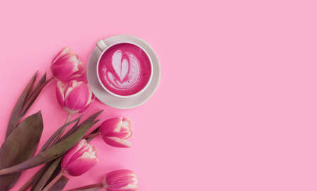 cup of coffee, flower tulip on a colored background Reklamní fotografie