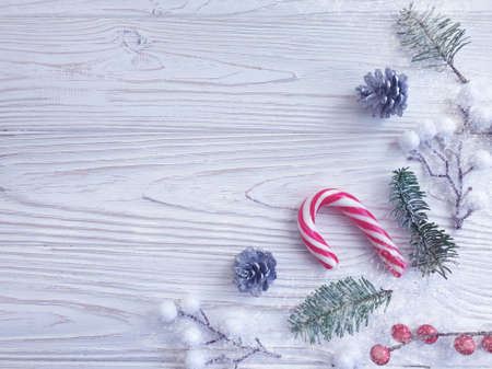 branch of a christmas tree, candy on a wooden background Reklamní fotografie