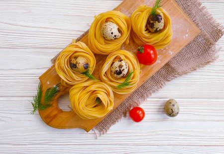 homemade pasta, tomato on wooden background Reklamní fotografie