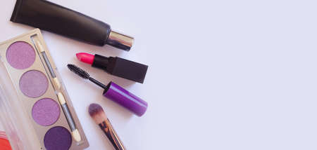 different decorative cosmetics on a light background