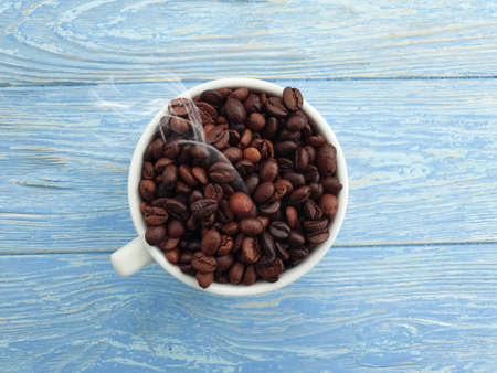 cup, coffee grain on wooden background