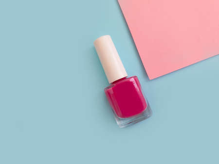 bottle of nail polish on a colored background