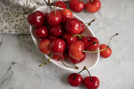 fresh cherries on concrete background Фото со стока