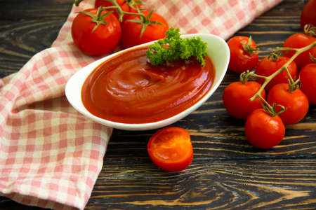 tomato ketchup on wooden background