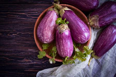 whole eggplant on wooden background