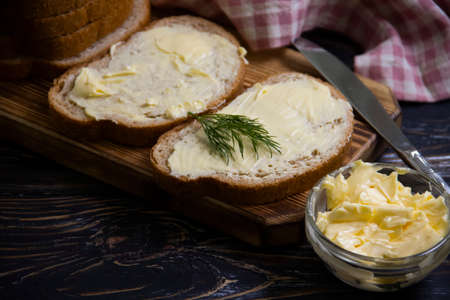butter, bread, parsley on a wooden background
