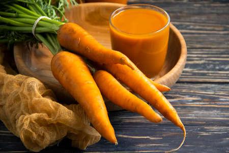 fresh carrot on a wooden background farm, vegetarian