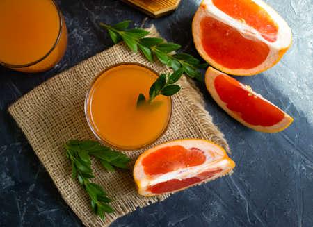 grapefruit juice on a concrete background Фото со стока