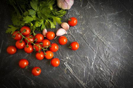 cherry tomato on concrete background