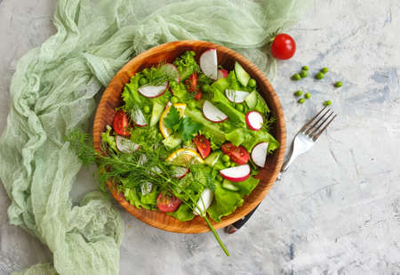 salad in a plate on a concrete background