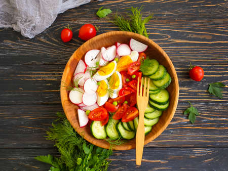 fresh vegetable salad on a wooden background Фото со стока