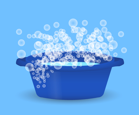 Blue bowl with water and soap suds, laundry, cleaning and hygiene Stockfoto - 105700842
