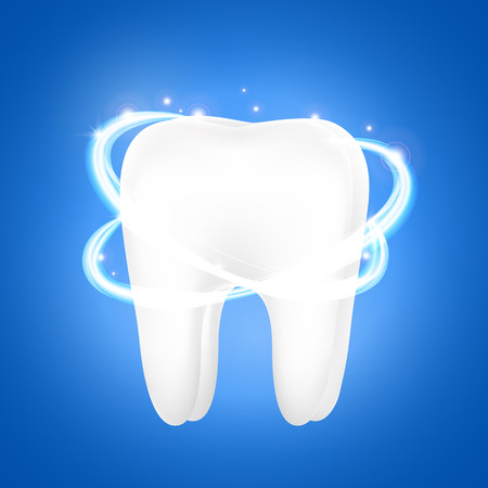 Tooth on a blue background. Dentistry concept