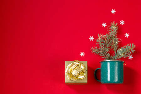 Golden gift box, Christmas tree decoration with snowflakes and hot drink with marshmallows on  red Stock Photo