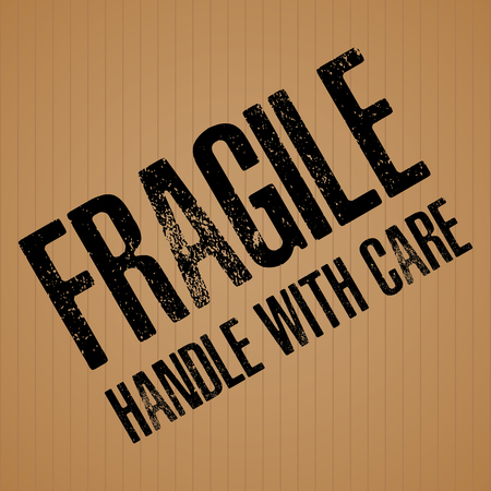 Fragile Black text on brown cardboard texture background.