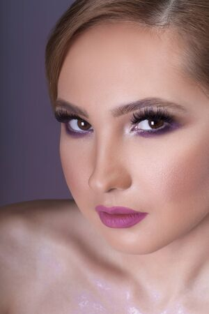 Creative pink and violet woman make up Stock Photo