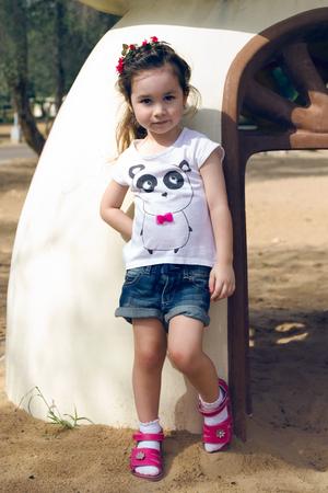 Serious litttle girl outdoor in denim Stock Photo