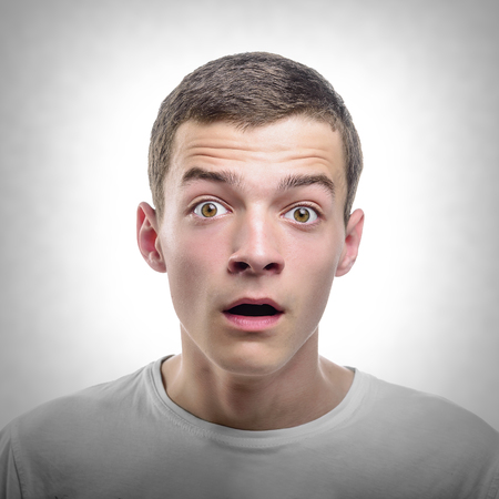 Portrait of Surprised Young Man. Toned photo.
