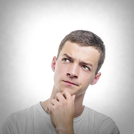 facial expression: Portrait of handsome young thoughtful man. Toned photo