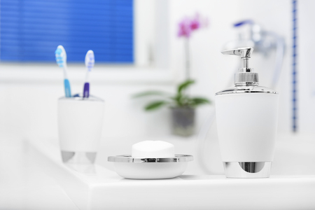 personal hygiene: Beautiful accessories in white bathroom. Personal hygiene items. Stock Photo