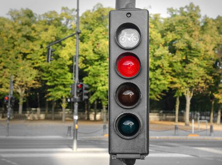 onwards: Traffic lights with a red color on the background of the road.
