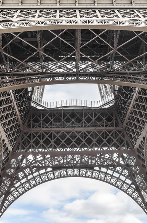 french culture: Part of the the Eiffel Tower. View from below.