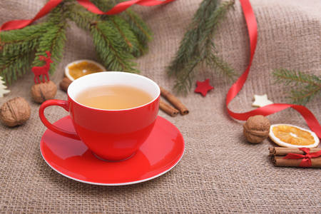 christmas decor: Red cup in the Christmas decor close-up. Stock Photo