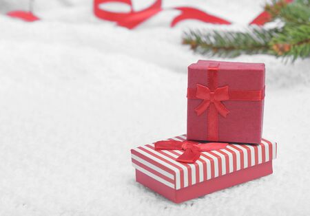 christamas: Red Christmas present on white background with Christmas tree and red ribbon. Stock Photo