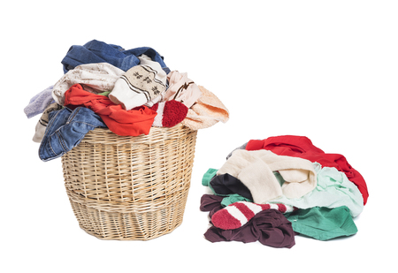 Basket with linen for laundry. On a white background. Reklamní fotografie