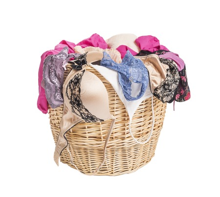 Women's underwear in the for laundry basket. Isolate on white background.
